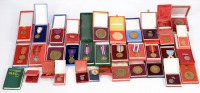 Set of medals, awards, and badges in etuies []