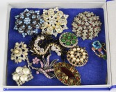 Collection of rhinestone brooches - 11 pieces []