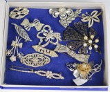 Collection of rhinestone brooches - 15 pieces []