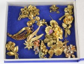 Collection of floral brooches []