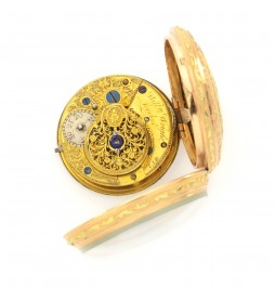 Gold pocket watch with a hunting scene
